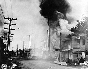 Parañaque - A burning building along Taft Avenue which was hit during the Japanese air raid in Barrio Parañaque, 13 December 1941.