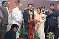 Pratibha Devisingh Patil lighting a lamp at the 61th All India Commerce Conference, at Dhanwate National College, Nagpur in Nagpur. The Governor of Maharashtra, Shri S.C. Jamir, the Chief Minister of Maharashtra.jpg