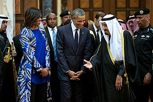 President Barack Obama and First Lady Michelle Obama walk with King Salman of Saudi Arabia at Erga Palace in Riyadh, Saudi Arabia, Jan. 27, 2015