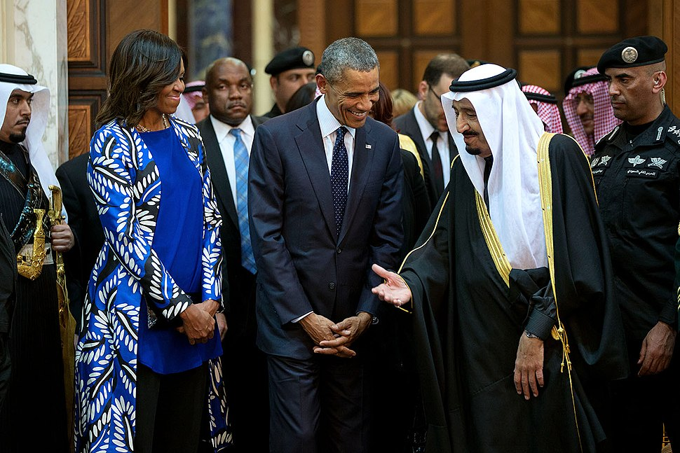 President Barack Obama and First Lady Michelle Obama walk with King Salman of Saudi Arabia at Erga Palace in Riyadh, Saudi Arabia, Jan. 27, 2015.jpg