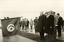 The Times (neutral) 220px-President_Habib_and_his_Romanian_guests_paying_tribute_to_Tunisian_national_flag