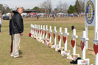 Tornado outbreak of March 3, 2019 - President Donald Trump and First Lady Melania Trump visit a memorial for victims in Alabama