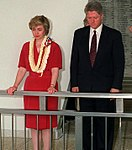 President William Jefferson Clinton and Hillary Rodham Clinton observe a moment of silence at the Arizona Memorial (cropped).jpg