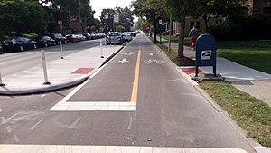 U.S. Route 23 in Ohio - Protected bike lane and bus stop island on Summit Street near the Ohio State University campus