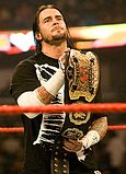 CM Punk as one half of the World Tag Team Champions