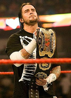 CM Punk as World Tag Team Champion.