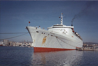 Queen Elizabeth 2 - Berthed in Málaga Spain 1982, with her original white funnel repainted red. Her hull is painted grey, a short lived decision.