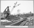Queensland State Archives 3675 Rocklea workshops stacking steel in stockyard Brisbane 1 July 1936.png