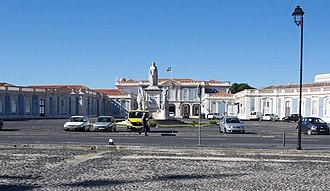 Palace of Queluz - The palace's public face to the town: the entrance from the cour d'honneur. Architecturally the most severe of the palace's many façades, it gives no hint of the architectural excesses beyond (see key 2).