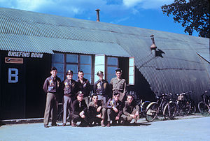 RAF Horham -  A bomber crew of the 95th Bomb Group outside a Nissen hut briefing room at Horham, August 1944.