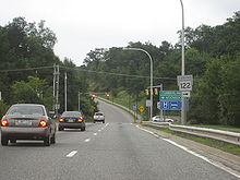 Ground-level view of an at-grade intersection with a traffic signal