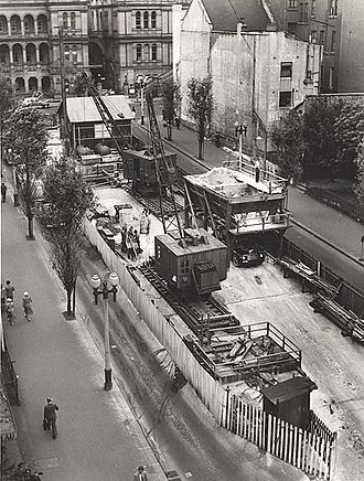 Martin Place - Eastern end of Martin Place during the construction of Martin Place station under the street. The buildings with exposed backs have now been replaced by the Reserve Bank of Australia building.