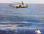Recovery helicopter from the USS Guadalcanal hovers over the Apollo 9 spacecraft.jpg