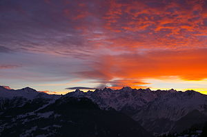 An orange/red Sunset viewed from Verbier, Swit...