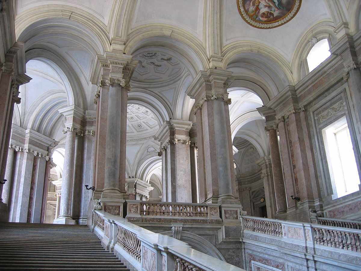 Sweeping marble staircase inside the Palace of Caserta