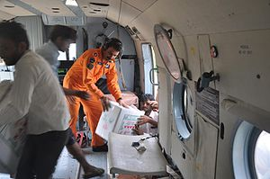 July 2015 Gujarat flood -  Indian Air Force personnel disrtibuting relief material