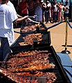 Ribs and other foods being cooked at a barbecue party.jpg