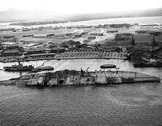Ford Island - USS Oklahoma, righted to about 30 degrees on March 29, 1943, during salvage at Pearl Harbor
