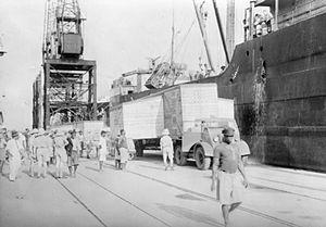 Gold Coast in World War II - British war material being offloaded in Takoradi in the Gold Coast