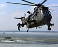 Royal Marine jumps into the sea from Sea King helicopter MOD 45147719.jpg