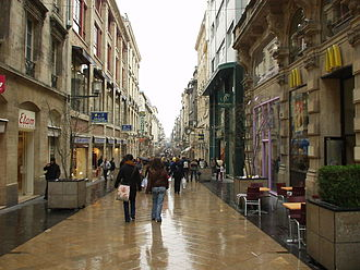 Rue Sainte-Catherine (Bordeaux) - Rue Sainte-Catherine in Bordeaux, France on a rainy spring day.