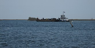 Mississippi River–Gulf Outlet Canal - Tugboat and barge in MRGO at Shell Beach, St. Bernard Parish