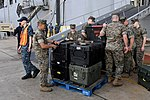Sailors from USS Iwo Jima loads supplies prior to the ship getting underway. (30108630091).jpg