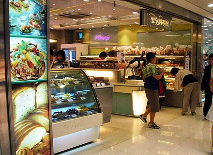A branch of Saint Honore Cake Shop, a Hong Kong chain bakery, in Hong Kong. Saint Honorius (Honore) is the patron saint of bakers and confectioners. Saint Honore Cake Shop Outlet01.jpg