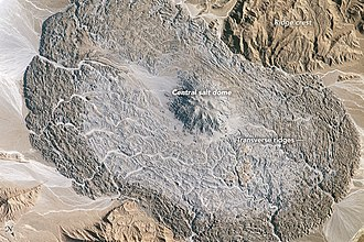 Salt glacier - ISS image of an oval-shaped salt glacier, about 14 km (8 mi) across, in the Zagros Mountains. Note north arrow pointing towards lower right.