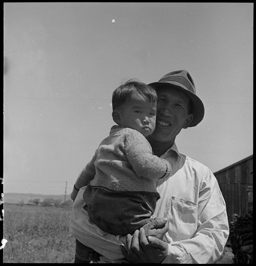 San Lorenzo, California. Farm laborer with his little son a few days prior to evacuation from this . . . - NARA - 537862