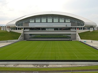 Sapporo Dome - Retractable grass field shown outside the stadium