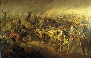 Painting of a combat showing white-coat infantry in march with some cavalrymen as well as a general and his staff on the foreground.