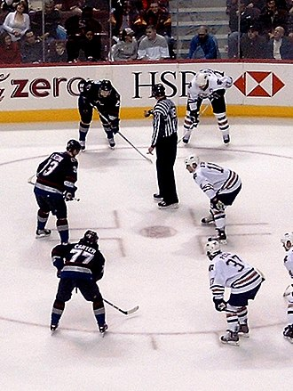 Anson Carter - Anson Carter on the bottom left of a faceoff with the Vancouver Canucks