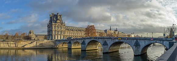 The Seine River the Pont Royal and the Louvre in Paris in France
