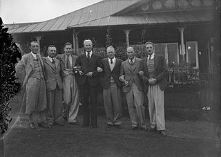 Seven men outside Llandrindod Wells Golf Club pavilion