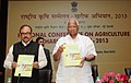 Sharad Pawar releasing a book at the National Conference on Agriculture Kharif Campaign 2013, in New Delhi on March 06, 2013. The Minister of State for Agriculture & Food Processing Industries, Shri Tariq Anwar is also seen.jpg