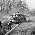 Sherman tanks of 4-7th Dragoon Guards, 8th Armoured Brigade move up to support the attack on Goch, Germany, 17 February 1945. B14678.jpg