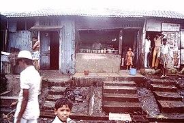Slums-of-Mumbai-1979-Shop-with-steps-IHS-87-01.jpeg