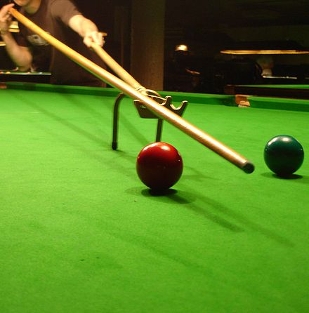 An extended spider, which can be used to bridge over balls obstructing a shot that is too far away to be bridged by hand - Snooker