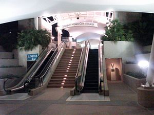 Palm Springs International Airport - The Sonny Bono Concourse, with Bono's bust to the right of the escalator.
