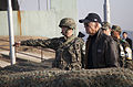South Korean Army 1st Lt. Choi Min Kyu, left, points across the border into North Korea while briefing U.S. Vice President Joe Biden Dec. 7, 2013, during a visit to Observation Post Ouelette in South Korea 131207-N-SZ959-223.jpg