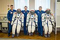Soyuz MS-02 crew members with their space suits.jpg