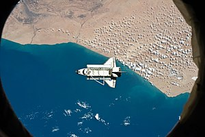 Space Shuttle Discovery Over Tarfaya in Morocco - NASA International Space Station 03-07-11.jpg