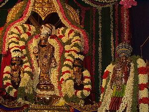 Thirumal - Srinivasa Perumal idols with flowers, Mylapore, Chennai, Tamil Nadu.