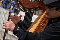 Street musician in Montmartre - harp 1, Paris April 2011.jpg