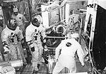 Suit technician Joe Schmidt assists Apollo 11 backup lunar module pilot Fred W. Haise, Jr., left, and James A. Lovell, backup crew commander, into lunar module for manned altitude run.jpg