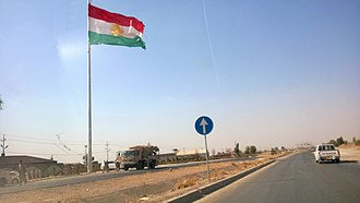 2017 Iraqi Kurdistan independence referendum - The flag of Kurdistan flies over the disputed city of Kirkuk after it was abandoned by Iraqi forces in June 2014 as the ISIL militant group approached.