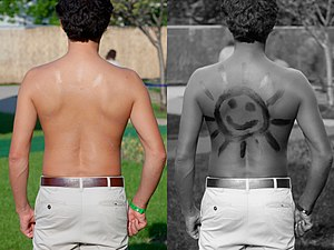 Tan line - Sunscreen on back under normal and UV light
