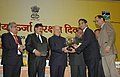 Sushilkumar Shinde presenting the award for excellence in energy conservation management to the GM, Western Railway, Shri R.N. Verma, at the National Energy Conservation Day function, in New Delhi on December 14, 2009.jpg