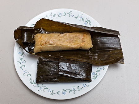 Salvadorean tamales are made in banana or plantain leaves, and the masa (corn meal) is often seasoned with chicken stock. Tamales Salvadorenos 2.jpg
